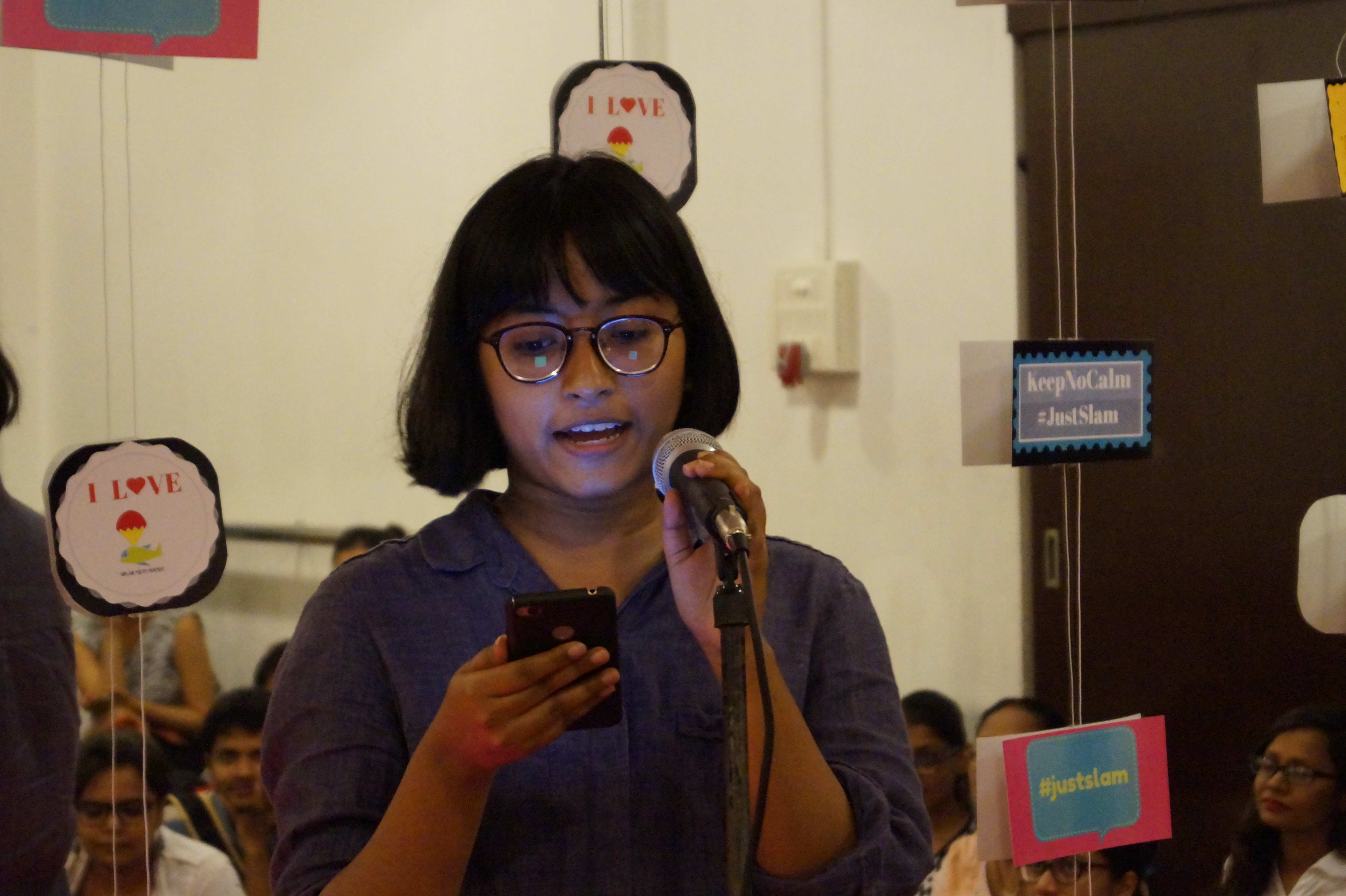 Damayanti Saha performing at Papercup and Airplane Poetry Movement Poetry Slam