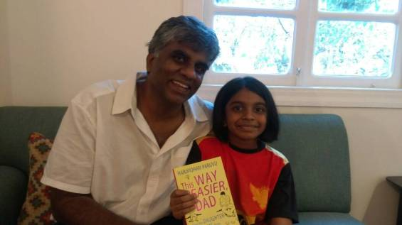 Author Harimohan Paruvu with daughter Anjali holding a copy of This Way is Easier, Dad: How My Daughter Saved Me From Growing Up